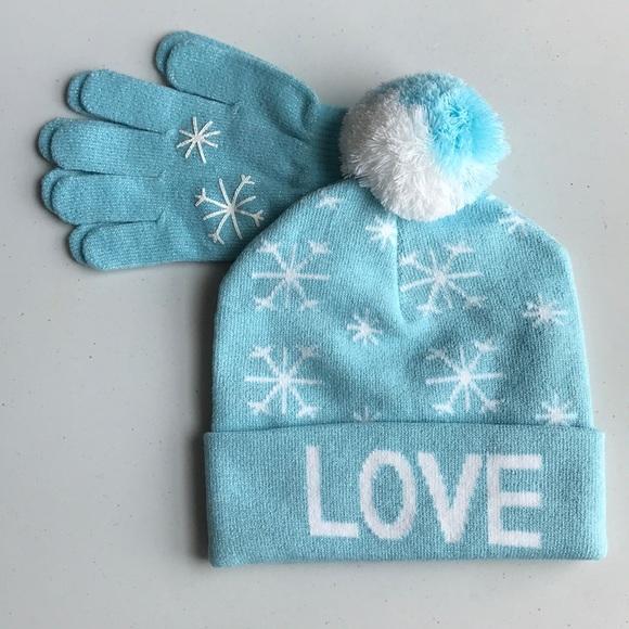 2872a678a0d2b Girl s Winter 2pc Set Blue Snowflake Hat   Gloves. NWT.  M 5b7db00dcdc7f73a6c9b9058. M 5b7db03c5fef37056bb56bab